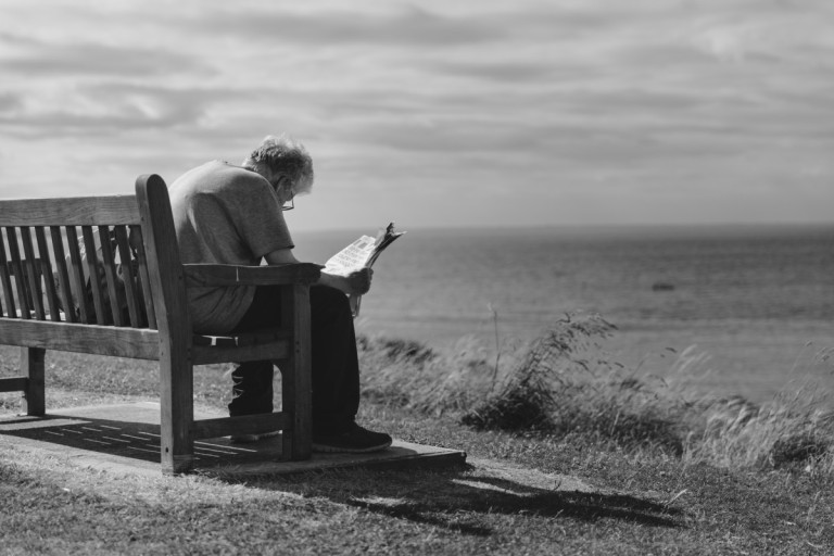 adult_beach_bench_black_and_white_cloudy_skies_grassy_lake_man-1040702.jpg!d